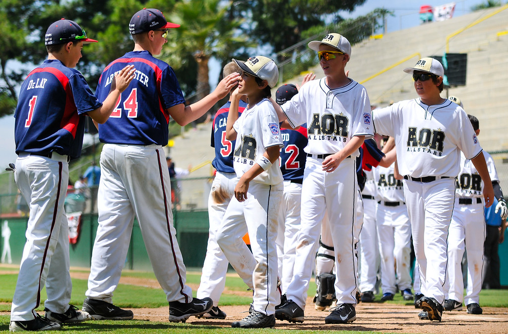 Description of . Alaska little leaguers, right, congratulate Washington, left, on their win after getting defeated by them 2-10 in the Little League Northwest Regional Tournament opening game in San Bernardino on Friday, Aug. 2, 2013. The tournament will run August 2 through 10, which host 12 states representing the West and Northwest Little League regions. (Rachel Luna / Staff Photographer)