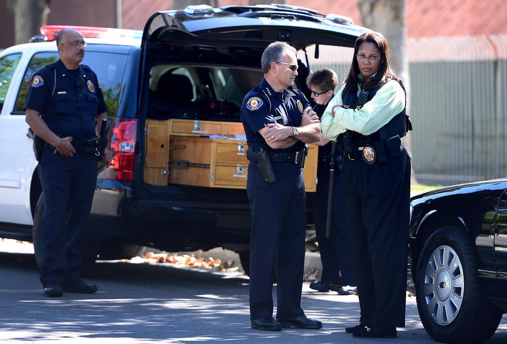 Description of . Pasadena Police Chief Phillip Sanchez and Detective Sgt. Tory Riley standby as Pasadena Police investigate an officer involved shooting at Kings Village in Pasadena Friday, October 11, 2013. (Photo by Sarah Reingewirtz/Pasadena-Star News)