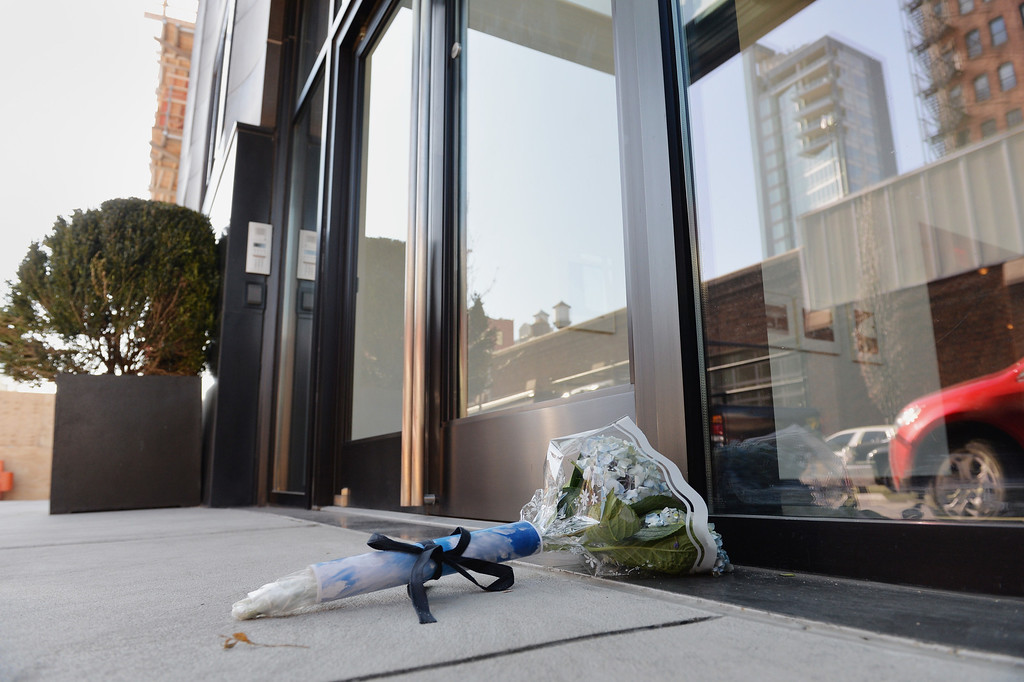 Description of . Flowers placed outside the apartment building of fashion designer L'Wren Scott, girlfriend of Rolling Stones frontman Mick Jagger, in New York on March 18, 2014. L'Wren was found dead at her apartment on March 17.          (STAN HONDA/AFP/Getty Images)