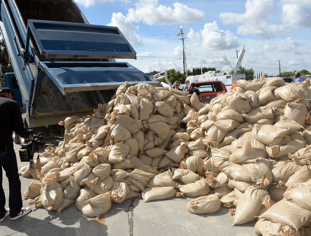 Description of . Trucks deliver sandbags for the K-rails at the Glendora City Yard in Glendora on Thursday February 27, 2014. (Staff Photo by Keith Durflinger/San Gabriel Valley Tribune)