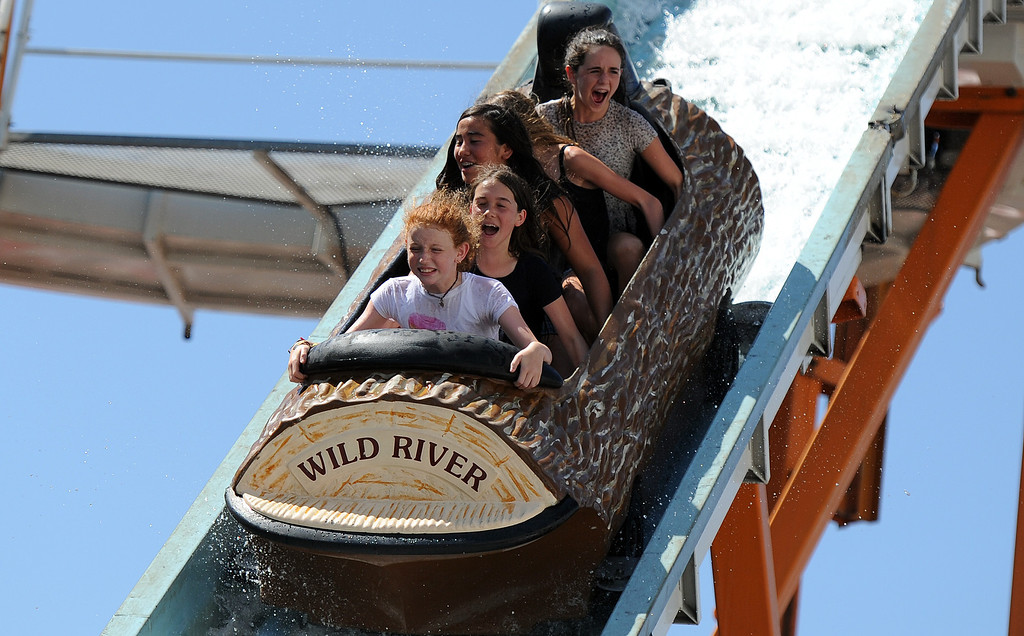 Description of . Kids and adults enjoy the Wild river log ride during the 91st Annual L.A. County Fair in Pomona, Calif. on Thursday, Sept. 5, 2013.   (Photo by Keith Birmingham/Pasadena Star-News)