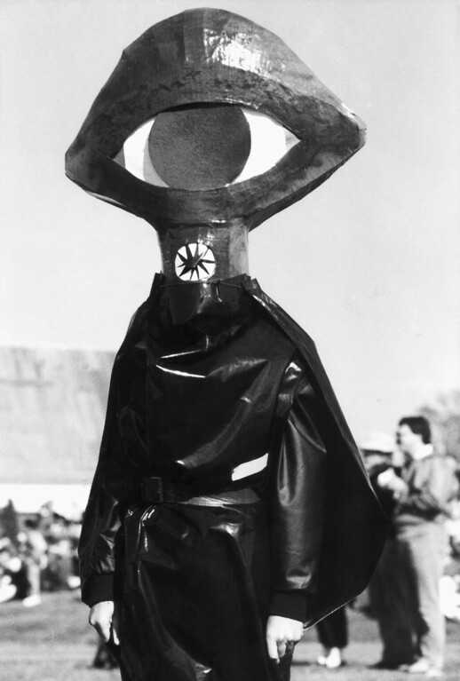 """Description of . A man dressed as an invading Martian walks through a field in Grovers Mill, New Jersey, Saturday, Oct. 29, 1988 during a celebration of the 50th anniversary of Orson Welles' """"War of the Worlds"""" radio show. The 1938 show featured factious Martians invading the New Jersey town, which unwittingly convinced up to 1 million Americans that the broadcast was real and the end of the world was at hand. (AP Photo/Chris Lischy)"""