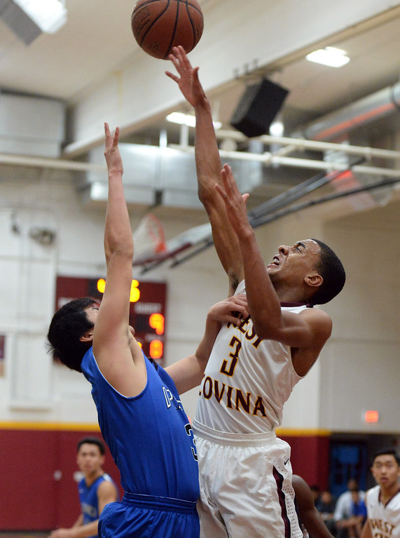 Description of . West Covina's Darrion Chavers (3) shoots against Diamond Ranch in the first half of a prep basketball game at West Covina High School in West Covina, Calif., on Wednesday, Jan. 8, 2014. (Keith Birmingham Pasadena Star-News)