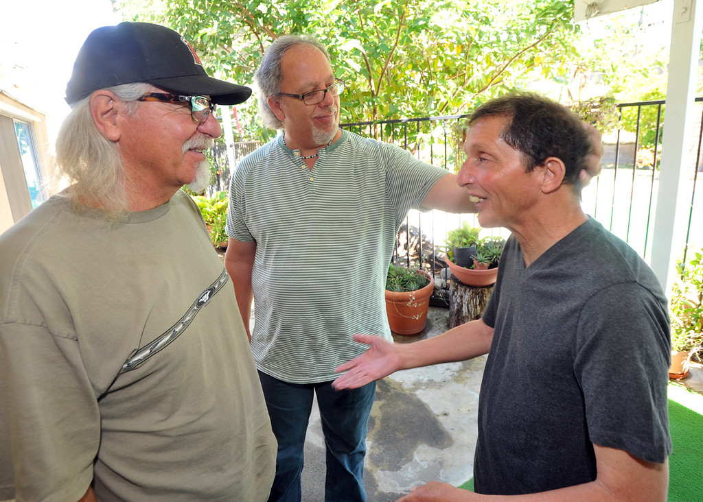 Description of . Gary Borack, 58, right, is joined by his brothers, Robert, left, and John at his group home in Mission Viejo on Wednesday June 26, 2013. Gary Borack, who was diagnosed with severe mental retardation at the age of 5, recently transitioned out of Lanterman Developmental Center in Pomona about 9 months ago, and is living successfully in the group home. (SGVN/Staff Photo by Keith Durflinger)