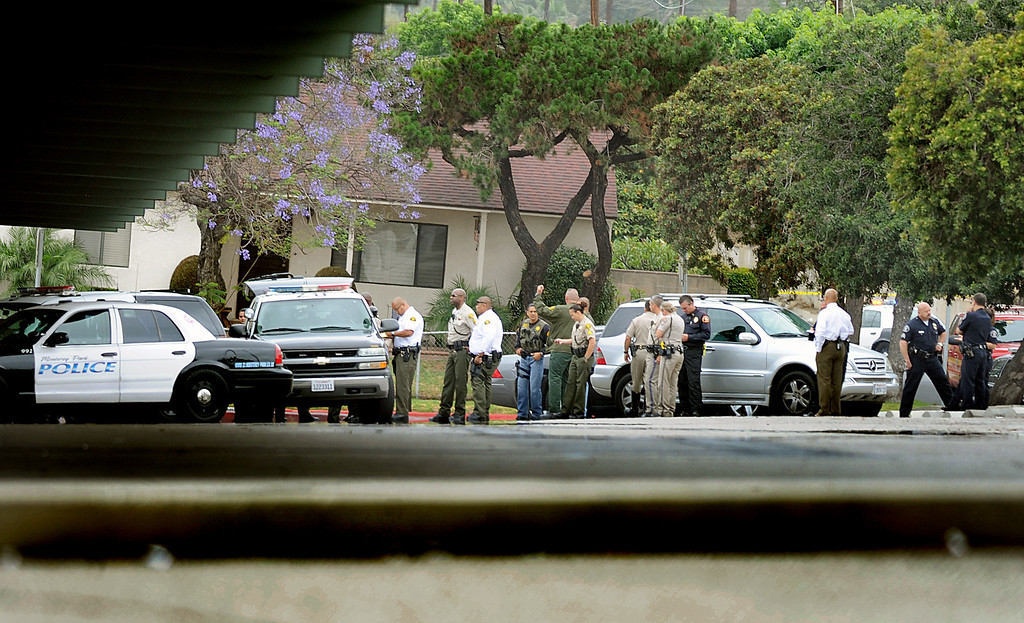 Description of . Monterey Park polce and Los Angeles County Sheriff's command post at East Los Angeles College. A 19-year-old man was arrested for allegedly making phone calls to the California Highway Patrol threatening gun violence against local schools on Thursday, May 16, 2013. When the suspect called to make the threat, he said he was en route to a college in Monterey Park, she said. The call was made from a cell phone and was received from the East Los Angeles and Monterey Park areas, officials said.About 14 schools were locked down during the incident. At about 9:30 a.m., Santa Monica Community College police arrested a suspect, a 19-year old male in connection with this threat as well as the Santa Monica threat,
