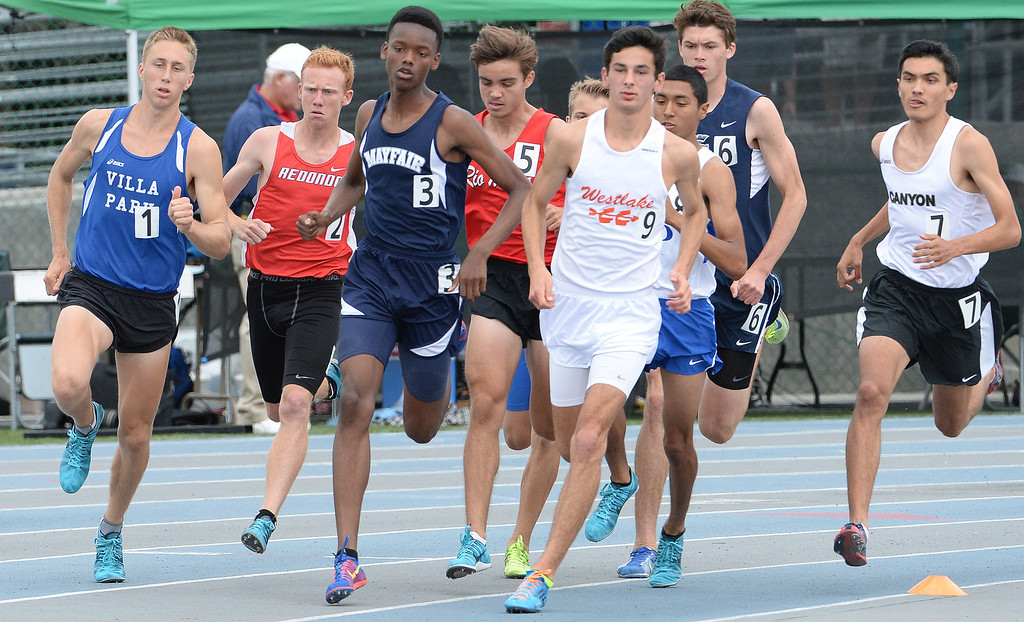 Description of . Mayfair's Ellis Newton competes in the division 2 1600 meter run during the CIF Southern Section track and final Championships at Cerritos College in Norwalk, Calif., Saturday, May 24, 2014. 