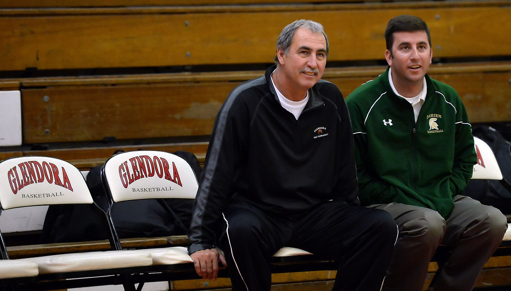 Description of . Damien head coach Matt Dunn, right, with Glendora head coach Mike Leduc prior to a Walnut vs. Damien game in the Glendora basketball tournament at Glendora High School in Glendora, Calif., on Friday, Dec. 13, 2013. Damien won 66-60.  (Keith Birmingham Pasadena Star-News)