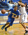 La Mirada's Tyler Payne (5) drives against Compton's Kevlin Swint (5)in a first round CIF Division 3AAA basketball game Wednesday night in Compton. 20130213 Photo by Steve McCrank / Staff Photographer