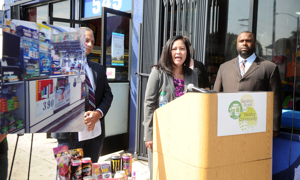 Description of . Cristin Mondy, RN, MSN, MPH, Los Angeles County area health officer speaks during a press conference announcing new data on the availability and marketing of tobacco, alcohol and food products in stores at Euclid Market in Los Angeles on Wednesday, March 5, 2014.  (Keith Birmingham Pasadena Star-News)
