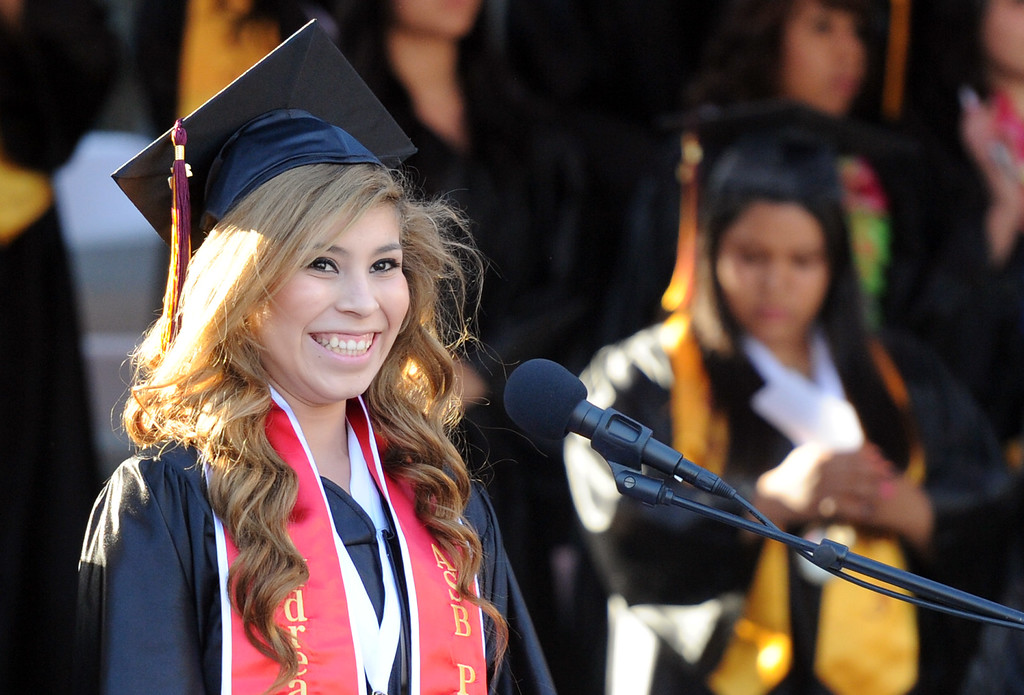 Description of . Andrea Arreguin smiles before the flag ceremony during the Vail High School commencement at Vail High School on Tuesday, June 18, 2013 in Montebello, Calif.