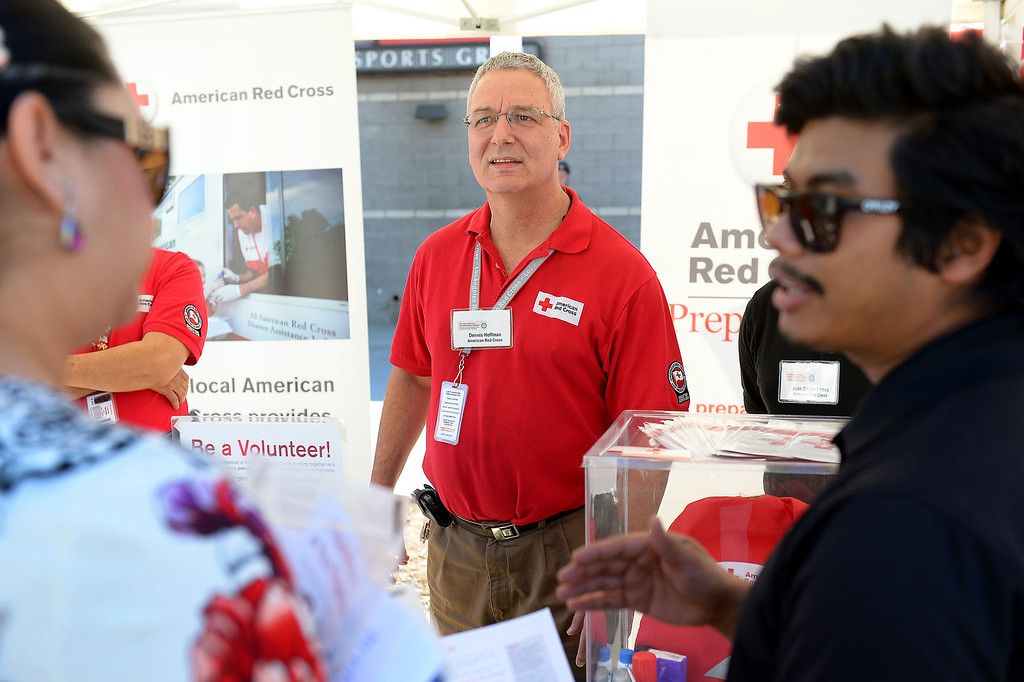 Description of . Dennis Hoffman answers questions at the American Red Cross booth at a symposium of exhibits and workshops presented by the Valley Economic Alliance at CSUN commemorating the 20th anniversary of the 1994 Northridge Earthquake, January 17, 2014. (Photo by Michael Owen Baker/L.A. Daily News)