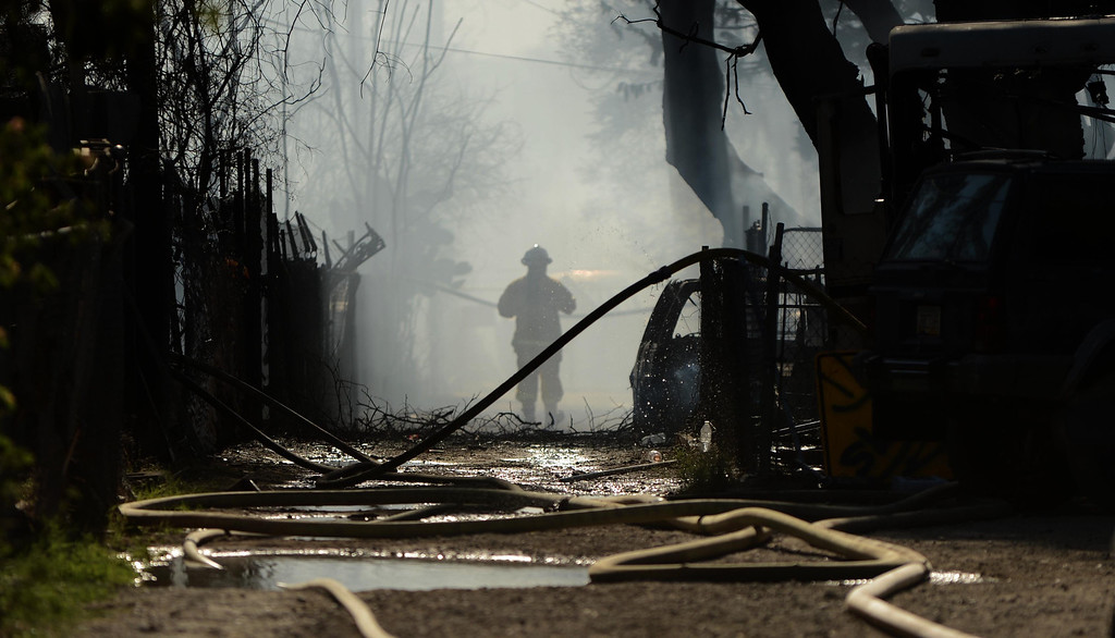 Description of . Firefighters battle a fire that destroyed at least 11 out buildings and 40 vehicles on Tuesday at 5900 Mission Blvd in Jurupa Valley.LaFonzo Carter/ Staff Photographer