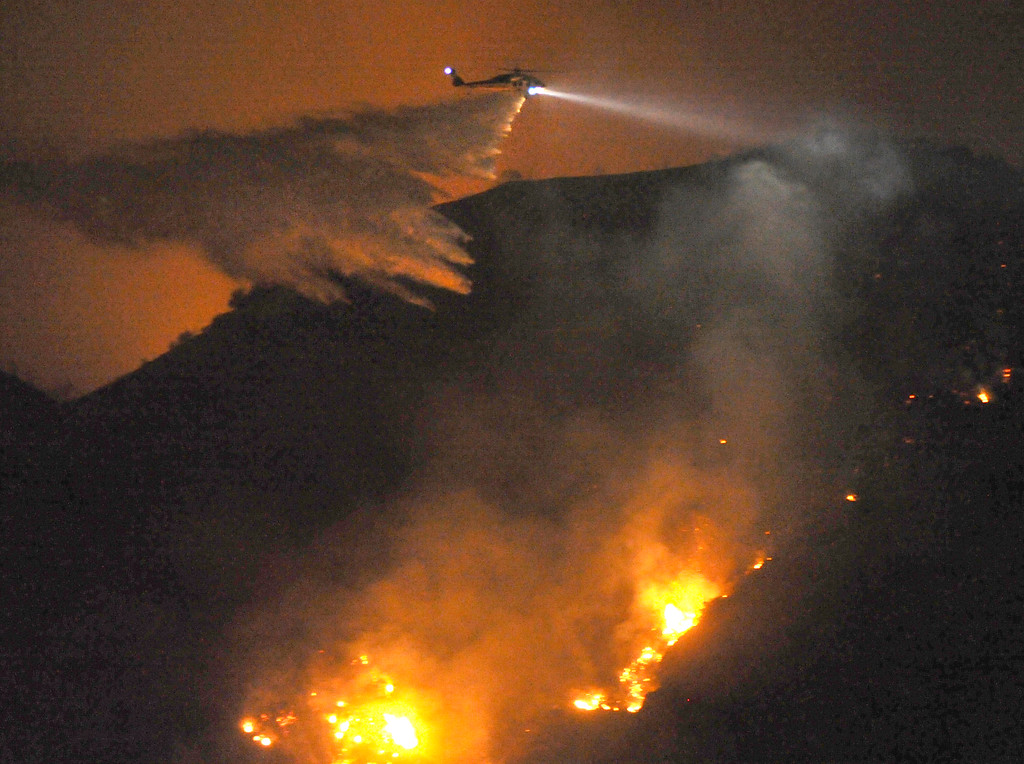 Description of . Los Angeles County Fire Department water dropping helicopters make night water drop to battle the Madre Fire in northwest of Highway 38 in Azusa on Monday September 23, 2013. (San Gabriel Valley Tribune/Staff Photo by Keith Durflinger)