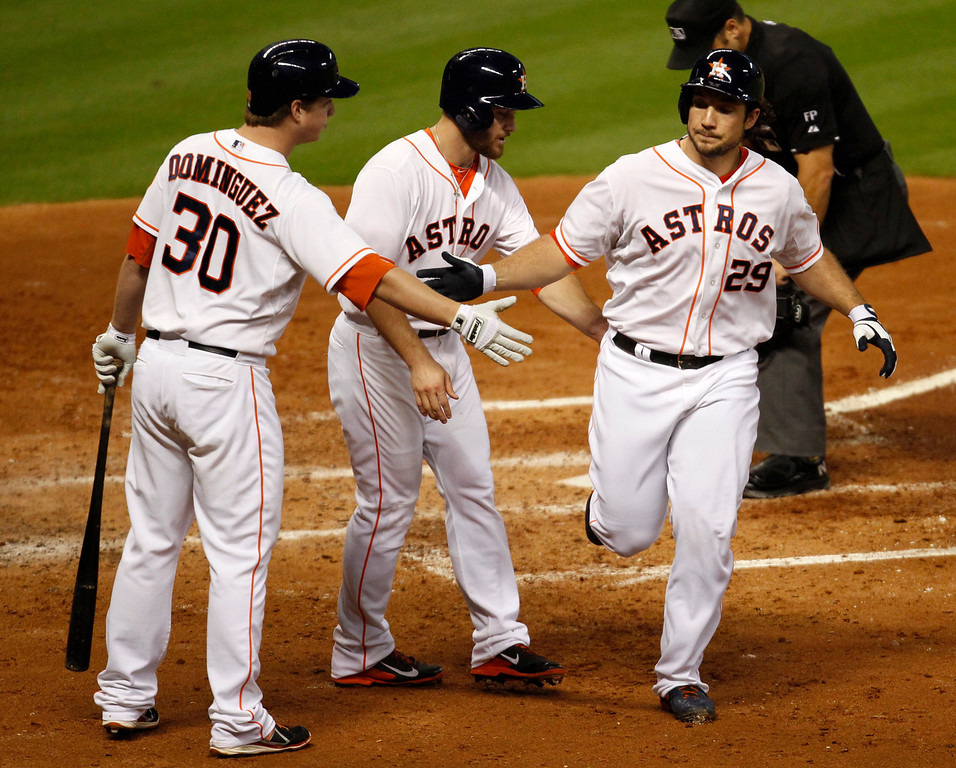 Description of . Houston Astros Brett Wallace, (29) is congratulated by teammates Matt Dominguez, (30) and Trevor Crowe after hitting a two-run home run in the fourth inning of a baseball game against the Los Angeles Angels Saturday, Sept. 14, 2013 at Minute Maid Park in Houston. (AP Photo/Eric Christian Smith)