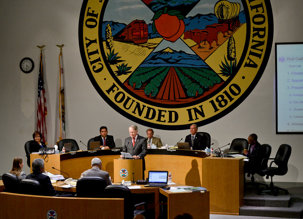 Description of . Councilman Jim Mulvihill gives a speech after getting sworn in at his first San Bernardino City Council meeting on Monday, Nov. 18, 2013. Mulvihill and new City Attorney Gary Saenz were sworn in at the first city council meeting since City Attorney James F. Penman and Councilwoman Wendy McCammack were recalled from those seats. (Photo by Rachel Luna / San Bernardino Sun)