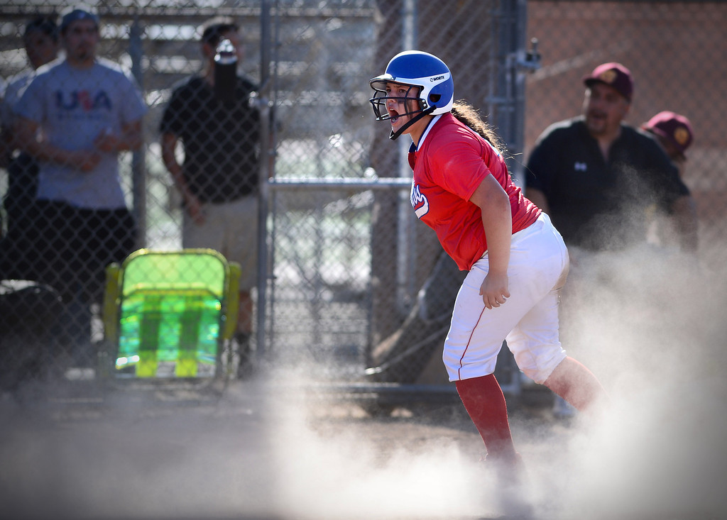 Description of . Los Altos' Berlynne Delamora brings in a run in the last inning defeating West Covina 4 to 3 Thursday, May 15, 2014 at West Covina High School. (Photo by Sarah Reingewirtz/Pasadena Star-News)