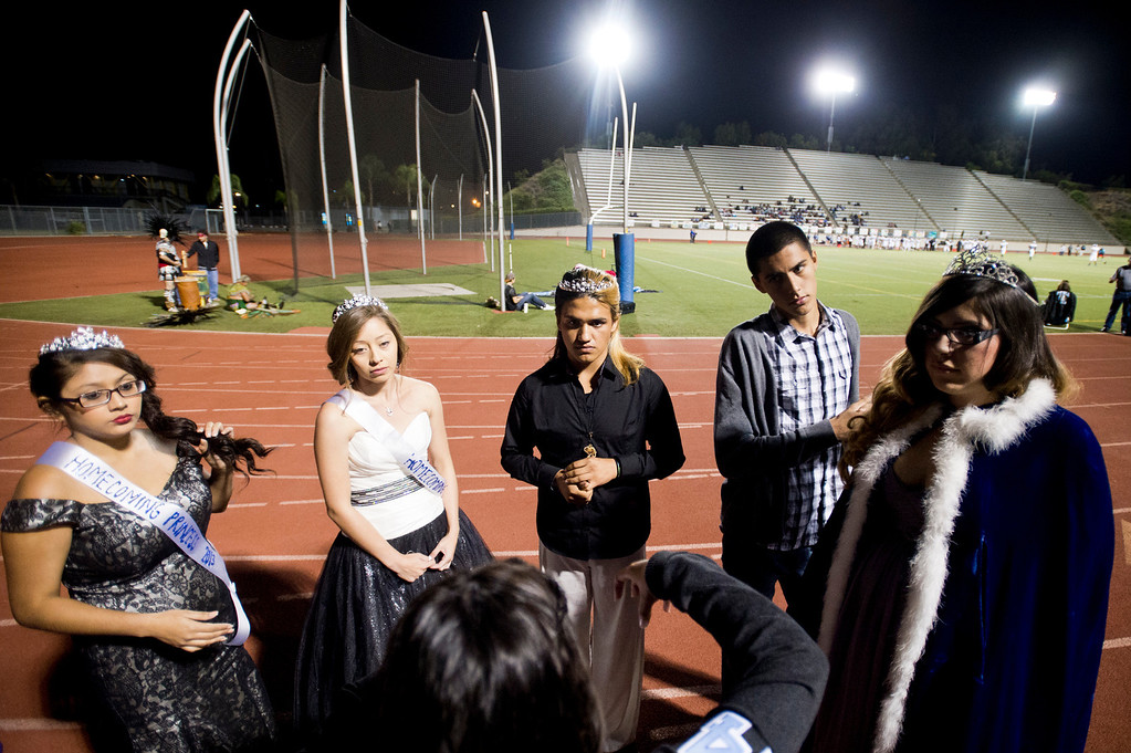 Description of . Patrick Cordova, 16, right, a transgender senior, center, listens to instructions  before the halftime show during the homecoming game at Citrus College Stadium in Glendora on Friday night, Sept. 27, 2013.( Photo by Watchara Phomicinda/ San Gabriel Valley Tribune)