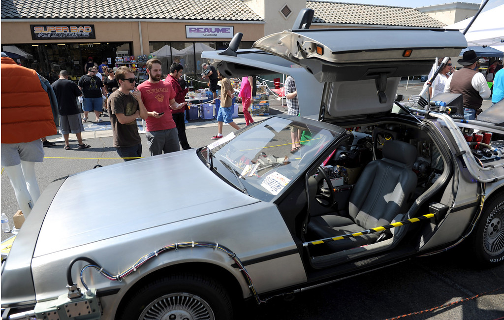 Description of . (John Valenzuela/Staff Photographer)  Chris Boutwelo and Glenn Liebler both of Redlands look at a replica Delorean time machines from the movie