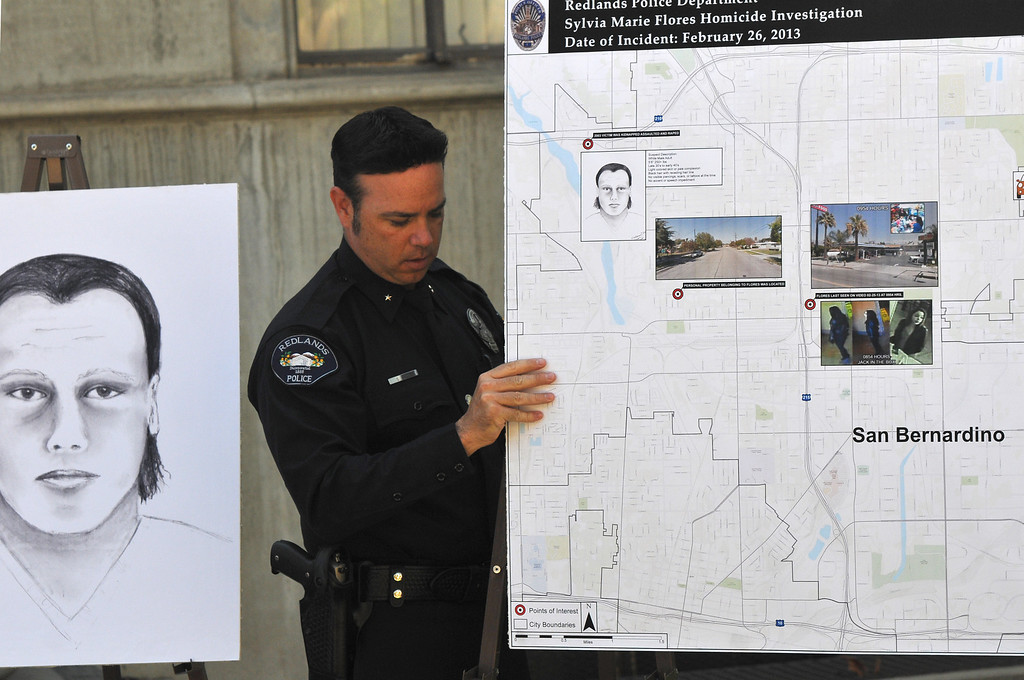 Description of . (John Valenzuela/Staff Photographer) Redlands Police officer Shawn Ryan adjust a map showing the whereabouts of Sylvia Flores the day she was murdered, at press conference outside the police annex in Redlands, CA.Tuesday, September 12, 2013. Flores, a 23-year-old woman from Perris, CA. who's body was found in a orange groves near Citrus Plaza shopping center in Redlands.