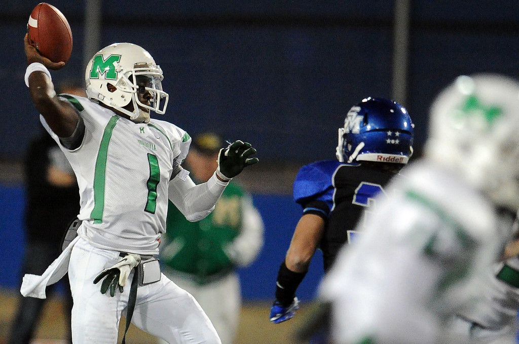 Description of . Monrovia quarterback Deshawn Potts (C) (1) passes against San Marino in the first half of a prep football game at Monrovia High School in Monrovia, Calif., on Friday, Nov. 8, 2013. 