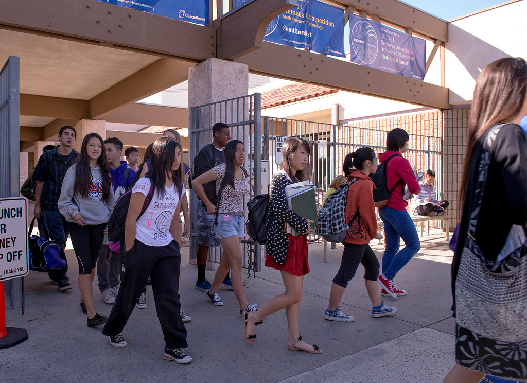 Description of . Diamond Bar High students evacuate out of classrooms during the Great ShakeOut earthquake drill at the Diamond Bar campus October 17, 2013.  (Staff photo by Leo Jarzomb/SGV Tribune)