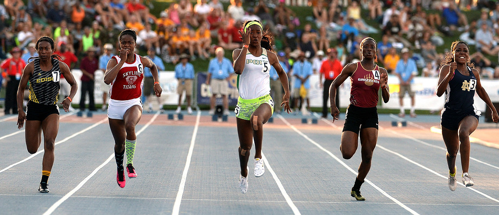Description of . Long Beach Poly's Ariana Washington, center, wins the 100 meter dash during the CIF California State Track & Field Championships at Veteran's Memorial Stadium on the campus of Buchanan High School in Clovis, Calif., on Saturday, June 7, 2014. 