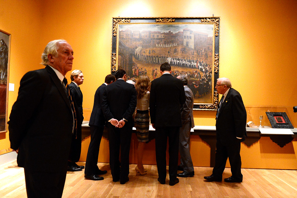 Description of . Professor Steven Hackel shows The Crown Prince Felipe and Princess Letizia of Spain and their Spanish entourage the Junipero Serra exhibition at The Huntington Library in San Marino Saturday night, November 16, 2013. (Photo by Sarah Reingewirtz/Pasadena Star-News)