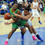 Long Beach Poly's Tania Lamb fights for the ball against Bishop Amat's Leeah Powell in the first half of a CIF State Southern California Regional semifinal basketball game at Bishop Amat High School on Tuesday, March 12, 2013 in La Puente, Calif. Long Beach Poly won 52-34. 