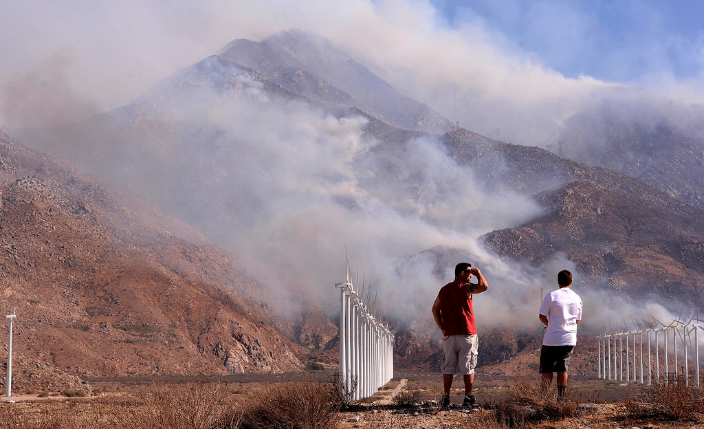 Description of . Two men watch the Silver Fire burn the mountains located between Cabazon and Palm Springs August 8, 2013.  GABRIEL LUIS ACOSTA/STAFF PHOTOGRAPHER.