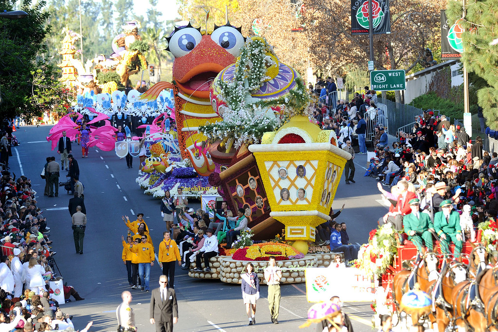 Description of . Floats make their way down Colorado Blvd. during the 2014 Rose Parade in Pasadena, CA January 1, 2014.(Keith Durflinger/San Gabriel Valley Tribune)