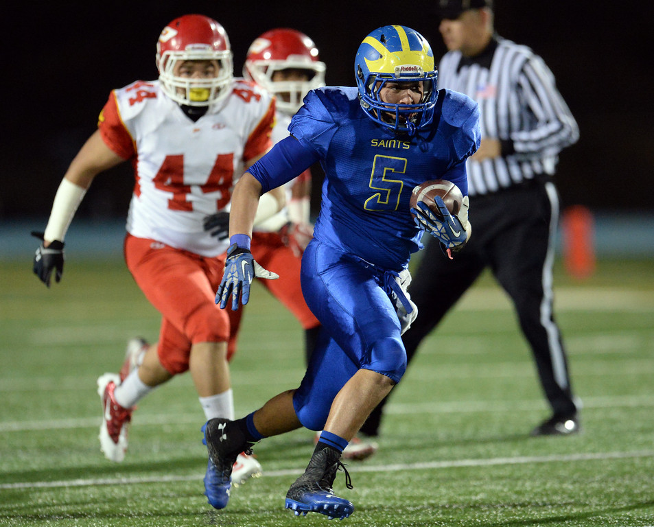 Description of . San Dimas' Fausto Martinez (5) runs for a 27 yard first down against Paraclete in the first half of a CIF-SS Mid-Valley Division championship football game at San Dimas High School in San Dimas, Calif., on Friday, Dec. 6, 2013.   (Keith Birmingham Pasadena Star-News)