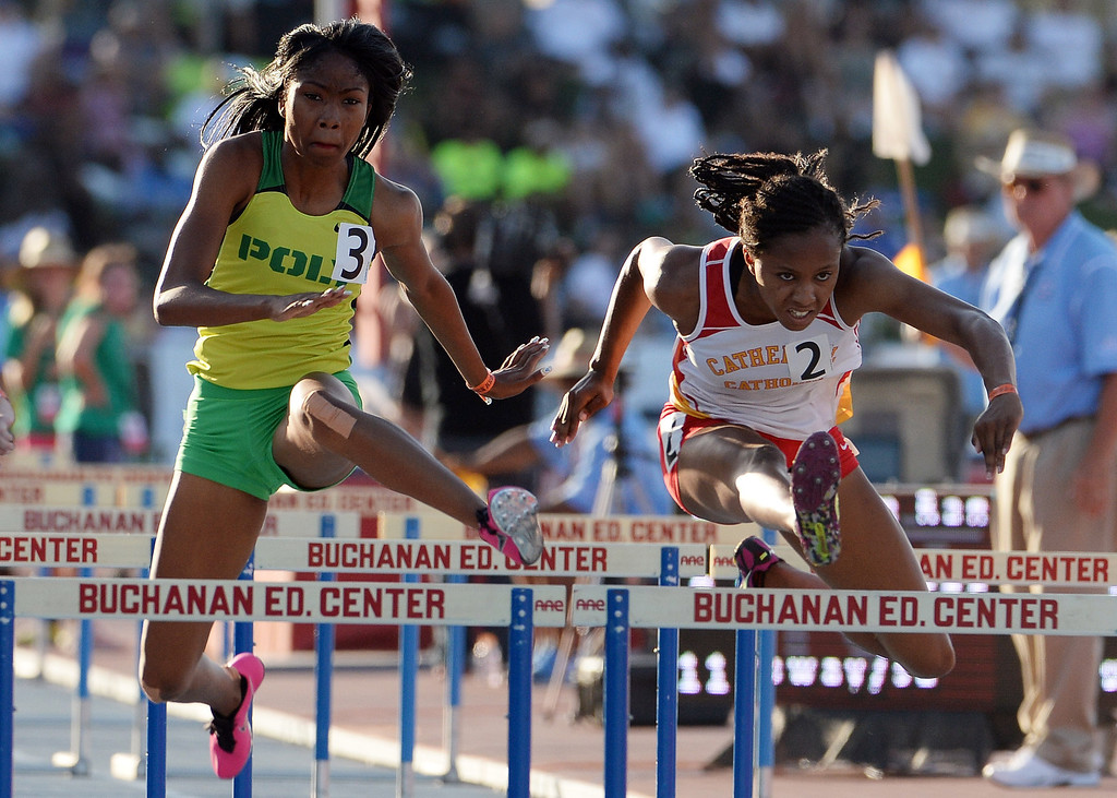 Description of . Long Beach Poly's Kymber Payne, left,  competes in the 100 meter hurdles competes in the during the CIF California State Track & Field Championships at Veteran's Memorial Stadium on the campus of Buchanan High School in Clovis, Calif., on Saturday, June 7, 2014.   (Keith Birmingham/Pasadena Star-News)