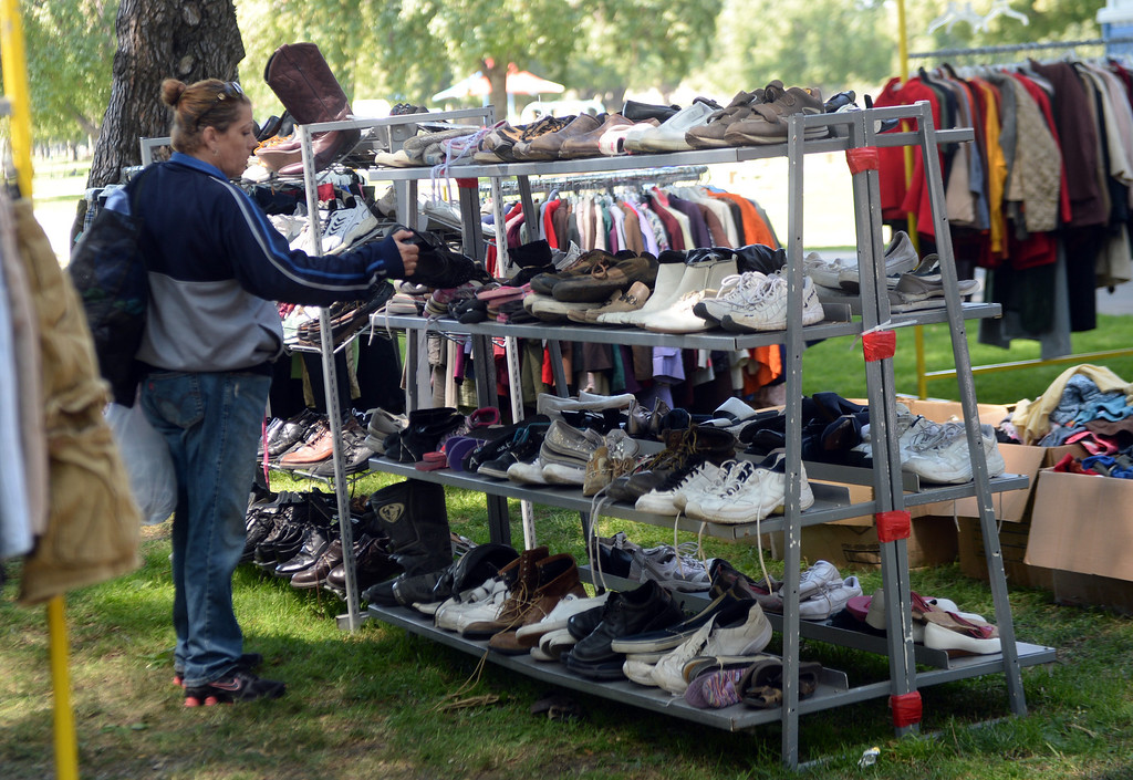 "Description of . Veterans were able to choose new clothing and shoes during ""Heroes in the Shadows"" San Gabriel Valley Homeless Stand Down, A three day event presented by The Vet Hunters Project and The SGV Veterans Employment Committee aims to combat Homelessness by providing on site assistance, services and resources to those in need at Whittier Narrows Recreation Park in South El Monte, Calif., on Saturday, April 5, 2014.  (Keith Birmingham Pasadena Star-News)"