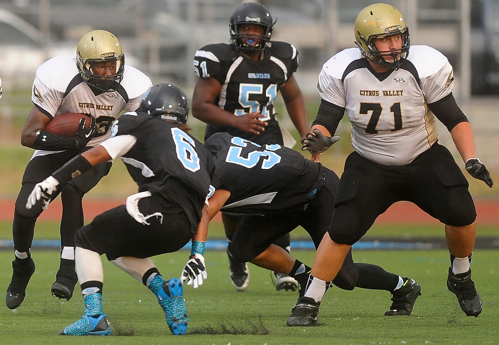 Description of . Citrus Valley football faces San Gorgonio High School in San Gorgonio's home season opener in San Bernardino on Friday, Aug. 30, 2013. (Rachel Luna / Staff Photographer)