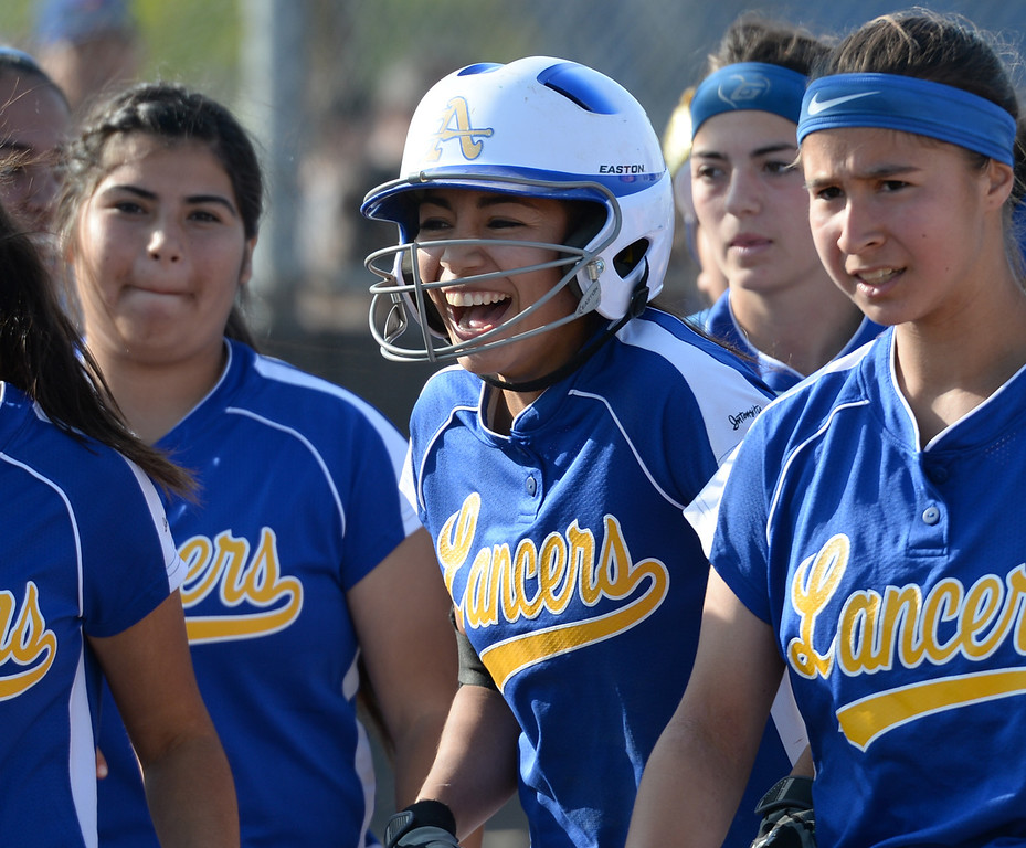Description of . Bishop Amat's Alyssa Barrera (#16) is congratulated by teammates after hitting her second homerun of the game as they play St. Paul in their Del Rey League girls softball game at York Field in Whittier on Thursday March 27, 2014. St. Paul defeated Bishop Amat 7-5. (Staff Photo by Keith Durflinger/Whittier Daily News)