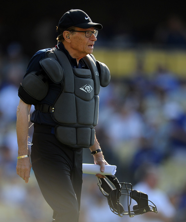 Description of . Tv host Larry King as the home plate umpire during the Old-Timers game prior to a baseball game between the Atlanta Braves and the Los Angeles Dodgers on Saturday, June 8, 2013 in Los Angeles.   (Keith Birmingham/Pasadena Star-News)