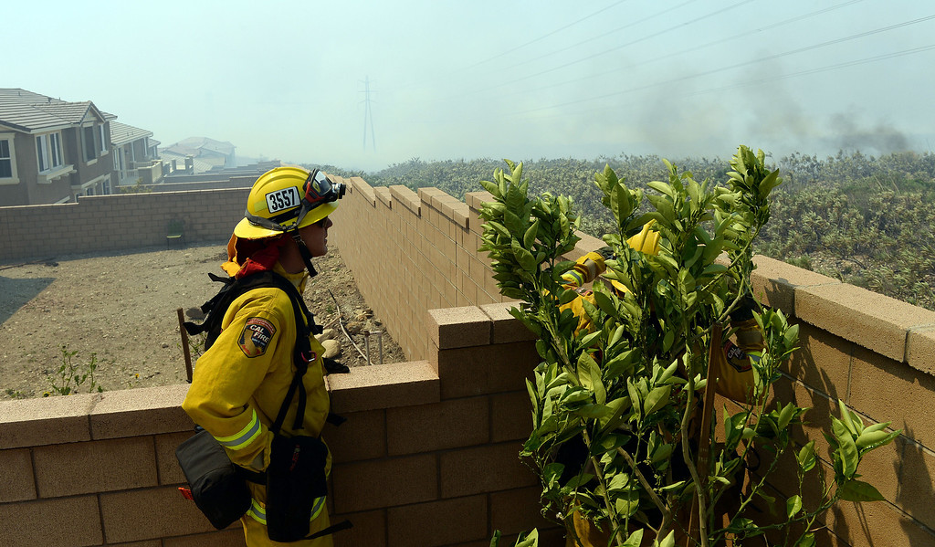Description of . Firefighters watch as the Etiwanda Fire moves south Wednesday in Rancho Cucamonga. Over 1,000 acres and over a 1,000 homes are under mandatory evacuation as the Etiwanda Fire burns in Rancho Cucamonga Wednesday April 30, 2014. Cause of the fire is unknown and is burning in areas which burned during the Grand Prix Fire in October 2003. (Will Lester/Inland Valley Daily Bulletin)