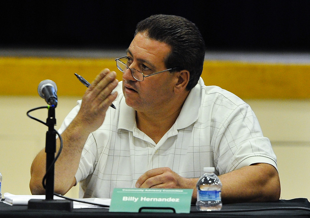 Description of . Billy Hernandez, a member of the Community Advisory Committee meeting, speaks to PG&E officials during the meeting, which the town's latest water problems and the closing of the town's school at Hinkley Elementary/Middle School in Hinkley, Calif. on Thursday, Feb. 28, 2013. Residents are recruiting signatures for a class action lawsuit against the Barstow Unified School District in a fight to save the town's only school. (Rachel Luna / San Bernardino Sun)