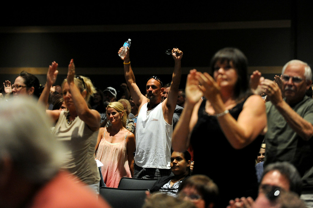 Description of . The audience stands and cheers after Chairman of the Board Supervisor Jeff Stone finished speaking during a town hall meeting on Wednesday, July 2, 2014 at Murrieta Mesa High School in Murrieta, Ca. The meeting is being held in response to immigrants who were being processed through a Texas Border Patrol Station and delivered to the Murrieta Border Patrol Station on Tuesday, which created protests from both sides of the immigration issue. (Micah Escamilla/The Sun)