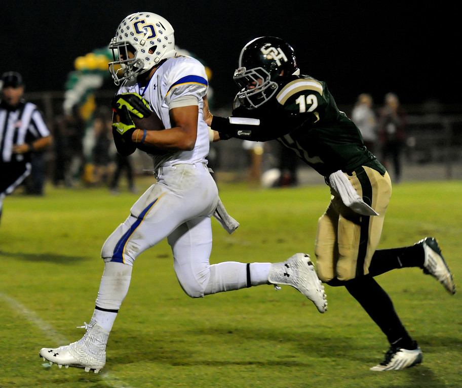 Description of . Charter Oak's Donavin Washington catches a pass for a 46 yard touchdown ahead of South Hills' Adam Goss (12) in the first half of a prep football game at Covina DIstrict Field in Covina, Calif., on Thursday, Oct. 24, 2013. 