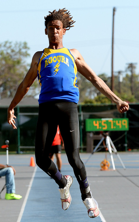 Description of . Agoura's Indrees Bernard competes in the long jump during the CIF-SS Masters Track and Field meet at Falcon Field on the campus of Cerritos College in Norwalk, Calif., on Friday, May 30, 2014.   (Keith Birmingham/Pasadena Star-News)