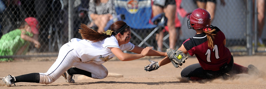 Description of . Northview's Haley Gomez tags out Barstow's Miranda Peralta (11) at third base in the seventh inning of a CIF-SS quarterfinal playoff softball game at Northview High School on Thursday, May 23, 2013 in Covina, Calif. Northview won 5-4.  (Keith Birmingham Pasadena Star-News)