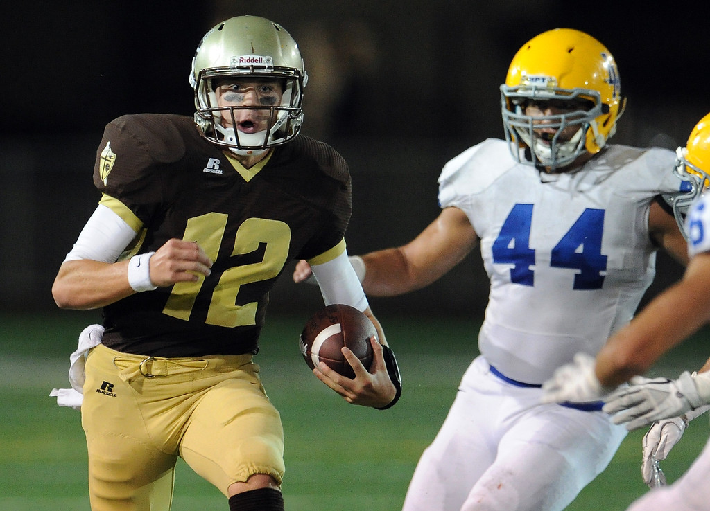 Description of . St. Francis' quarterback Ty Gangi (C) (12) scrambles for a first down against La Mirada in the first half of a prep football game at St. Francis High School in La Canada, Calif. on Thursday, Sept. 19, 2013.    (Photo by Keith Birmingham/Pasadena Star-News)