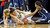 Sierra Canyon's Gabi Nevill and Zoe Goss work to recover a loose ball against Chloe Eackles of Pinewood during the 2013 CIF State Basketball Championships at the Sleep Train Arena, in Sacramento, Ca March 22, 2013.  Sierra Canyon won the game 47-33.(Andy Holzman/Los Angeles Daily News)