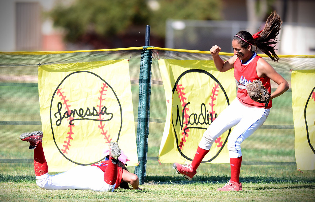 Description of . Los Altos Nadine Barragan dives for a ball as they defeat West Covina 4-3 Thursday, May 15, 2014 at West Covina High School. (Photo by Sarah Reingewirtz/Pasadena Star-News)