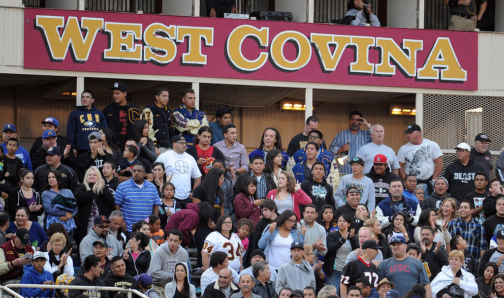 Description of . A full house during the annual East vs. West San Gabriel Valley Hall of Fame all-star football game at West Covina High School on Friday, May 17, 2013 in West Covina, Calif. 
