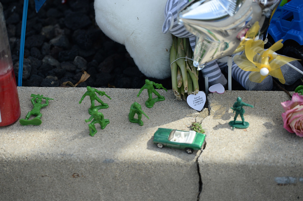 Description of . A memorial sits along Alta Loma Drive for Ryan Cruz Saldana, 3, a resident of South Pasadena, who was hit by a truck and killed Friday, near the intersection of Alta Loma Drive and Garnet Street. (Photo by John Valenzuela/Inland Valley Daily Bulletin)