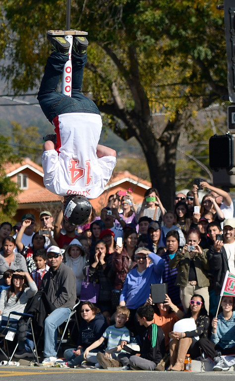 Description of . An Xpogo rider does a trick near the end of the parade route during the 2014 Rose Parade in Pasadena, CA January 1, 2014.(John McCoy/Los Angeles Daily News)