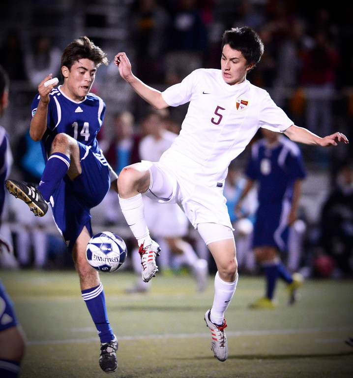 Description of . Arcadia's Forrest Hoffman (5) drives the ball as Anaheim's Alex Supancic (14) approaches during the quarterfinals at Arcadia High School Thursday, February 27, 2014. Arcadia was defeated 2-0. (Photo by Sarah Reingewirtz/Pasadena Star-News)