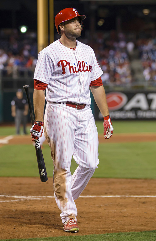 Description of . Philadelphia Phillies' Darin Ruf heads to the dugout after striking out with the bases loaded against the Los Angeles Dodgers to end to end the eighth inning of a baseball game, Friday, Aug. 16, 2013, in Philadelphia. The Dodgers won 4-0. (AP Photo/Christopher Szagola)